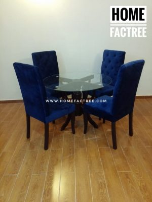 blue velvet fabric charis with round dinning table and glass top