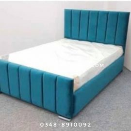 teal cushioned queen bed